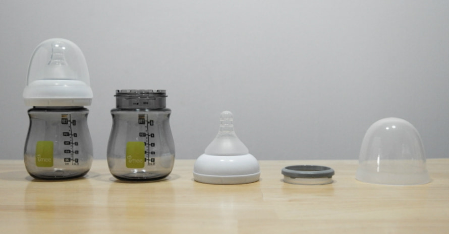 image of baby bottle components on the table