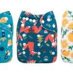 three cloth diapers with a funny print