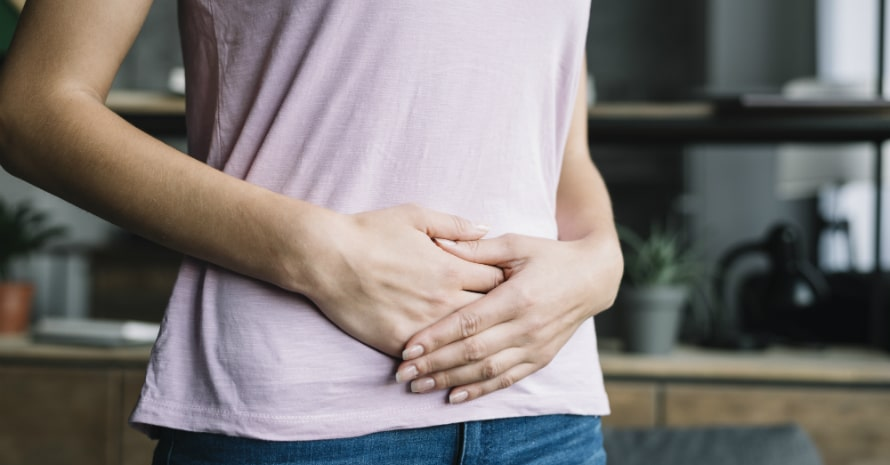 midsection-view-woman-suffering-from-stomach-pain