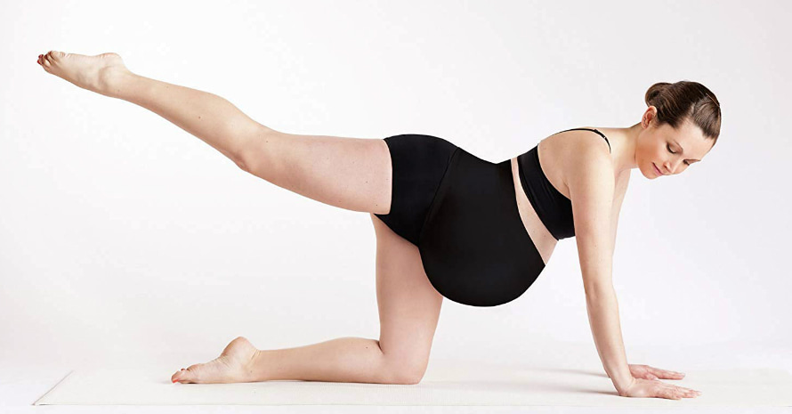 Woman-doing-stretching-in-a-black-maternity-belt