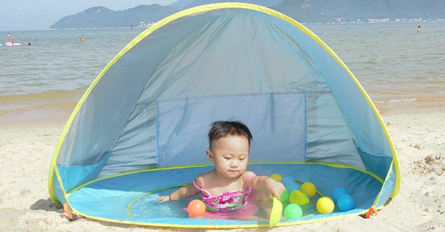 baby playing in the tent