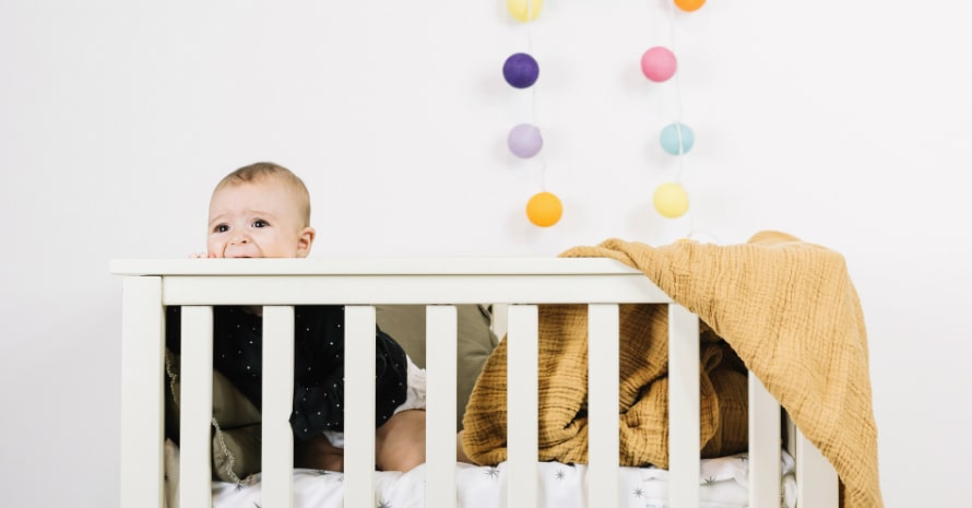 cute baby in the crib white background