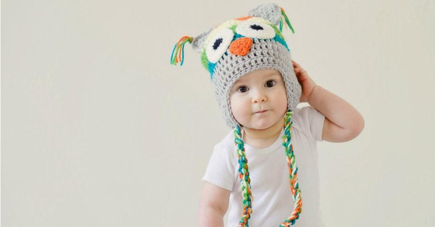 baby in wicker hat